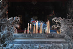 Incense Offerings. A photo taken on some smoldering incense at a Chinese temple Stock Image