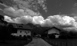 Clouds over the mountain. Photo taken somewhere in Austrian village and dramatic clouds was coming over the mountain royalty free stock images
