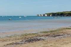 A photo taken on a spring day at Swanage beach looking towards the boats on the sea and the jurasic coast line Stock Image