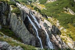 Giant waterfall in the mountains royalty free stock photos