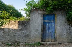 Bucolic door in a small village in Occitanie royalty free stock photography
