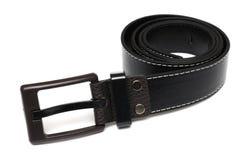 A black hypoallergenic black belt. A photo taken on a unisex black hypoallergenic polyurethane black belt against a white backdrop Royalty Free Stock Photography