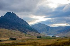 The mountain landscape of Snowdonia National Park under a cloudy sky royalty free stock photography