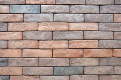 Light brown, red and grey bricks wall. A photo taken on a wall made of light brown, red and grey bricks Stock Photography