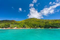 Praslin shoreline, Seychelles. A photo is taken on the way from Praslin island to Curieuse island from a ferry boat, Seychelles royalty free stock images