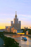 Photo of a tall building standing on the bank of the Moskva River at sunset Royalty Free Stock Images