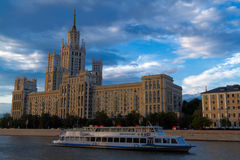 Photo of a tall building standing on the bank of the Moskva River at sunset Stock Photography