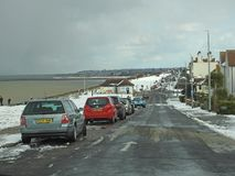 Winter snow in whitstable. Photo of tankerton in whitstable after snow has fallen with view looking east towards herne bay kent Royalty Free Stock Photo
