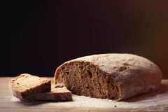 Photo of tasty fresh loaf of bread on the wonderful brown wooden Stock Images