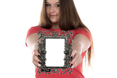 Photo of teenage girl showing photo frame. On white background Royalty Free Stock Images