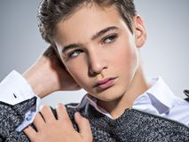 Photo of teenage handsome guy posing at studio Stock Photos