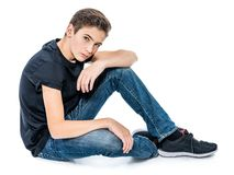 Photo of teenage handsome guy posing at studio Stock Images