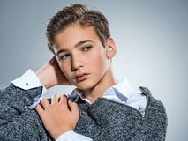 Photo of teenage handsome guy posing at studio Royalty Free Stock Photography