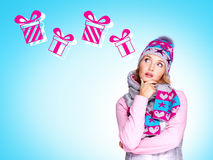 Photo of thinking woman  with illustration of gifts Royalty Free Stock Photo