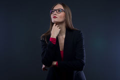 Photo of thinking woman looking up Stock Photo