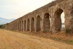 Photo of told aqueduct in Italy, ruins, yellow field Stock Images