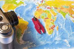 A photo on top of a journey, a world map, an old camera. Boat on the ocean map of the world Royalty Free Stock Image