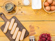 Photo on top of table with biscuits, eggs, raspberries. Creamy cream royalty free stock photos