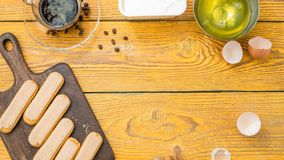 Photo on top of table with savoyardi cookies, coffee. Cream cheese. Place for text stock photos