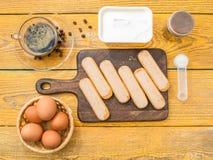 Photo on top of table with savoyardi cookies. Eggs, cream royalty free stock photo