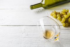 Photo on top of wine glass with wine, grapes, bottle Stock Image