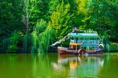 Photo of a tourist ship on a lake in a park at summer stock photography