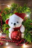 Toy bear with christmas toy and fir tree flashes by christmas tree lights stock photos