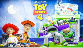 A photo of Toy Story mascot characters from left to right Jessie, Woddy and Buzz Lightyear. stock photography
