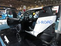Room for One Person. Photo of Toyota i road electric car at the washington dc auto show on 2/3/18.  the i road is an all electric 3 wheel motorcycle car for Stock Photos