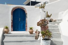 Photo of traditional building entrance in Santorini. Oia, Santorini Greece  - July 28, 2016: Photo of traditional house entrance in Santorini Stock Photo