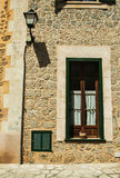 Photo of traditional house exterior. Vintage photo of traditional house facade in mediterranean village in Mallorca Spain Royalty Free Stock Photo