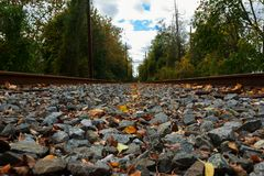 Photo from a train station's rail track when it is empty. Photo from a train station's rail track when it is empty rails waiting for the road railway stock photography