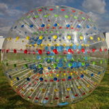 Photo transparent ball-Jogging - Zorba with multi-colored radial lines on the background of blue sky. Stock Photo
