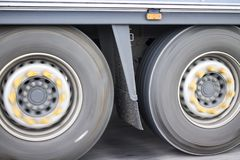 Photo of truck wheels in motion blur royalty free stock images