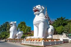 Mandalay, Myanmar (Burma). Photo of twin white lions in one the entrances to Mandalay royalty free stock images