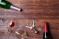 Photo of two bottles of wine, two wine glasses and corkscrew stock images