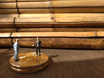 Two businessman mini figure toys, chit chat about bitcoin. Photo two businessman mini figure toys, chit chat about bitcoin royalty free stock image