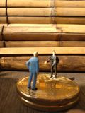 Two businessman mini figure toys, chit chat about bitcoin. Photo two businessman mini figure toys, chit chat about bitcoin royalty free stock images