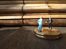Two businessman mini figure toys, chit chat about bitcoin. Photo two businessman mini figure toys, chit chat about bitcoin stock photography