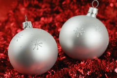 Photo of two christmass balls over red Royalty Free Stock Photos