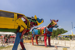 Photo of two cow sculptures from old car parts on the famous alternative (summer) Tollwood Festival Stock Photography
