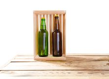 Photo of two different full beer bottles with no labels. Separate clipping path for each bottle included.2 two separate photos royalty free stock images