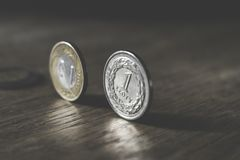 Photo of Two Gold-colored and Silver-colored Coins Standing on Floor Royalty Free Stock Image