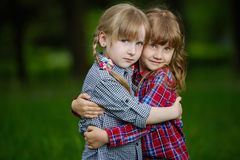 Photo of two happy hugging girls Royalty Free Stock Photos