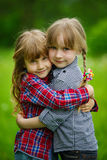 Photo of two happy hugging girls Stock Images