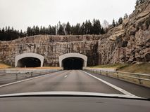 Photo of Two Highway Tunnels in Cliff Under Cloudy Sky stock photo