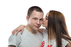 Photo of two kissing teenagers. On white background Stock Photos