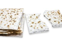 A photo of two pieces of matzah or matza isolated on white background. Matzah for the Jewish Passover holidays. Place for text, co. Py space. Selective soft Stock Photo