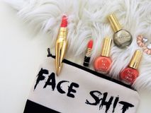 Photo of Two Red Lipsticks and Three Assorted-color Nail Polish Bottles stock photography