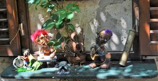 The Musicians performance. Photo of two small and funny statues of musicians performing in a garden in Dubrovnik - Croatia - July 2010 Stock Photography